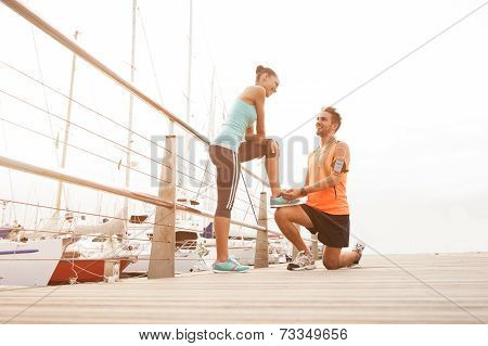 Young mixed race couple enjoying a morning run exercise poster