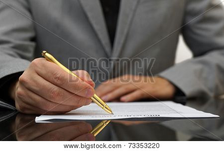businessman is fulfilling and signing contract, focus on pen poster