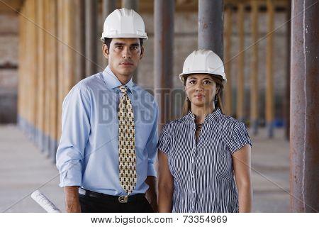 Multi-ethnic businesspeople wearing hard hats