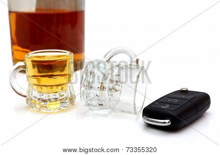 Concept Of Drunk Driver With  Bottle Of Whiskey, Glasses And Car Key