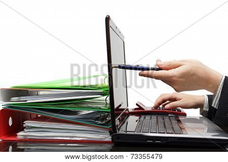 Auditor Pointing With Pen On Laptop Screen, Showing Financial Information