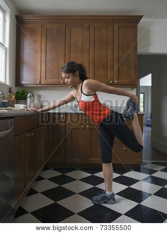 Pacific Islander woman stretching