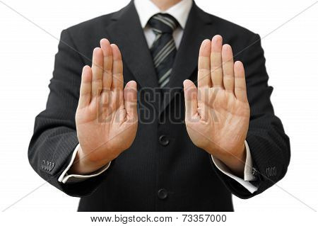 Businessman Showing Stop Sign On White Background