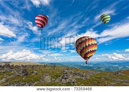 Three big multi-colored balloons