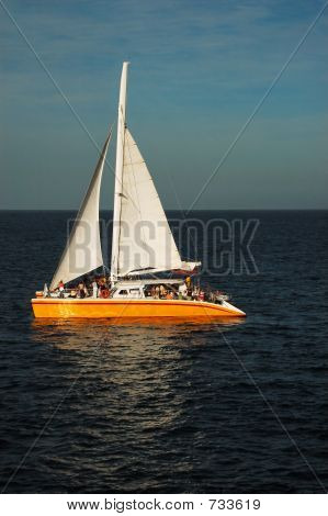 Catamaran at sea in the sunset