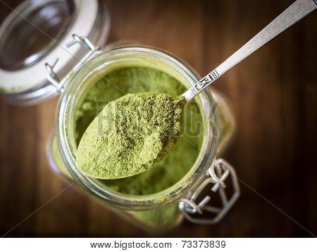 Moringa powder in a jar
