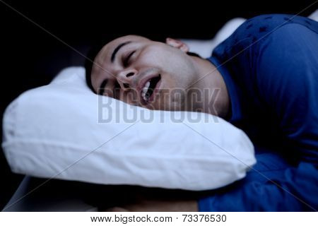 Portrait of a man sleeping soundly in his bedroom
