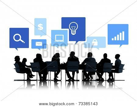 Sihouettes of Business People in a Meeting with Business Symbols