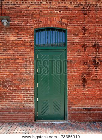 Green Door In Brick Wall