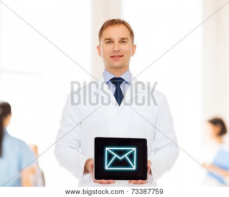 medicine, profession, and healthcare concept - smiling male doctor showing tablet pc computer screen over blue background