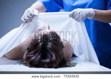 Covering Female Body In Mortuary