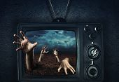 Zombie hand coming out of TV poster