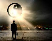 Rear view of businessman looking at yin yang sign poster