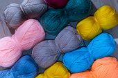 bright background of yarns of different colors poster