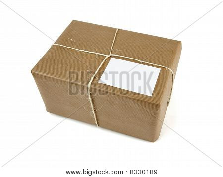 Brown Parcel Bound With String Isolated