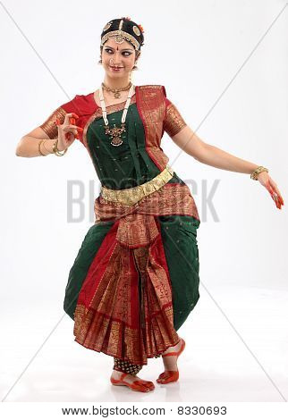 Woman performing bharatanatyam dance in rich religious dress poster