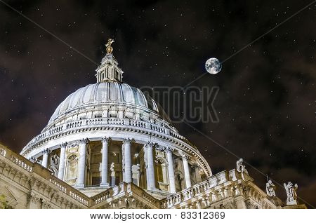 Night moon scene of St Paul's Cathedral located at the top of Ludgate Hill in the City of London poster