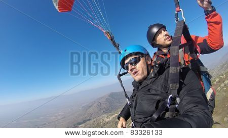 Two man paragliding