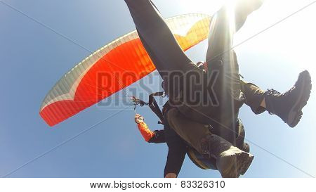 Tourist paragliding guided by a pilot