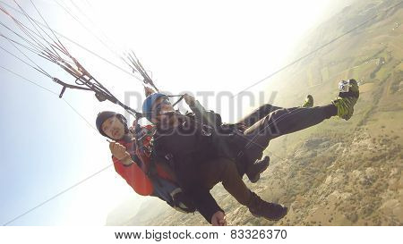 Paragliding high above mountain