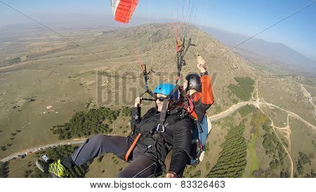 Tourist tandem paragliding guided by a pilot