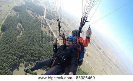Tourists enjoying the view while paragliding