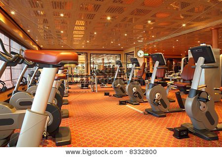 Large Gym Hall With Running Tracks, Exercise Bicycle And Dumbbells In Cruise Ship