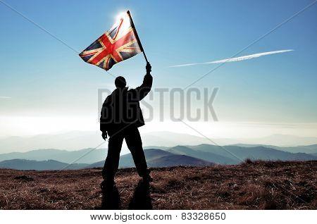 Winner waving UK flag