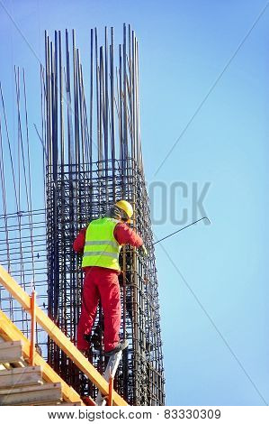 Construction Worker Knitting Steel Rods