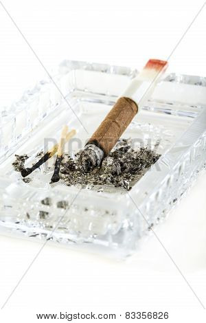 Cigarillos, Burnt Match In A Crystal Ashtray.