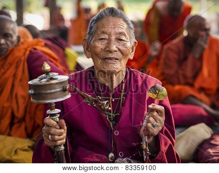 Buddhist Woman Praying At Mahabodhi Temple In Bodhgaya, India