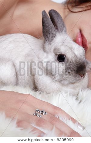 Girl sleeping with her pet pygmy rabbit poster