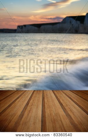 Landscape Image Of Sunset Over Birling Gap In England With Wooden Planks Floor