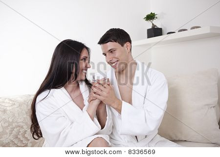 Young beautiful couple in white