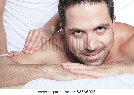 Man receiving Shiatsu massage from a professional masseur at spa