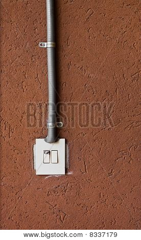 White Switch On A Abstract Rough Red Wall
