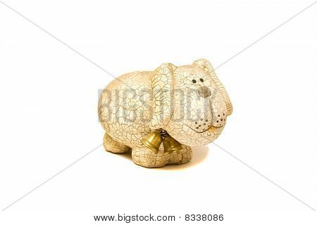 Ceramic figurine of dog with goldish bells is isolated on white background poster