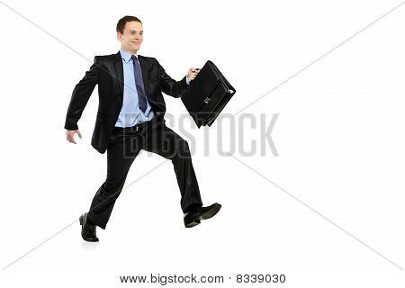 A view of a businessman running away