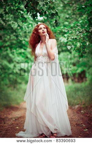 Beautiful Redhead Woman Wearing White Dress, In A Forest
