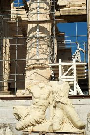 Two Sculptures At The Background Of The Acropolis.