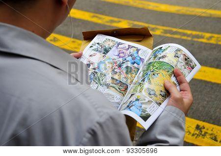 Man Reading Cartoon