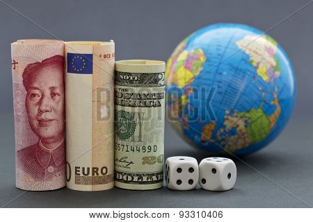 Global Risks Reflected In Three Currencies, Dice, And Globe