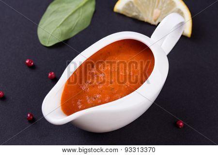 fresh tomato sauce in the white sauce boat