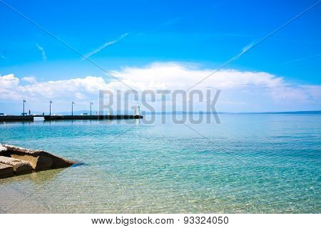 Pier At Sunny Day In Pefkohori, Greece