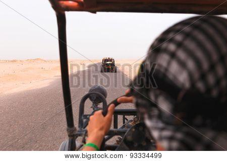 Men Riding Buggy Car In Desert
