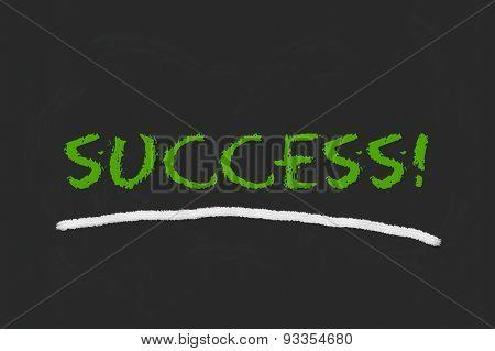 Success Green Script On A Blackboard