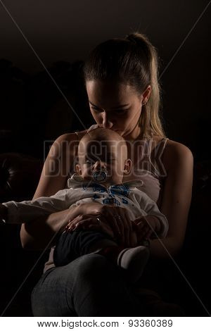 Overtired Single Mother With Her Baby .