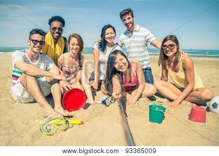 Friends With Selfie Stick On The Beach