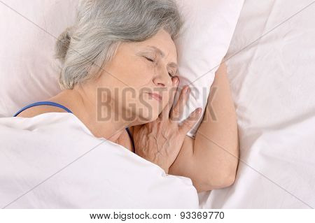 older woman sleeping in the bedroom