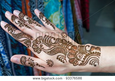 Painting Henna Paste On Woman's Hand